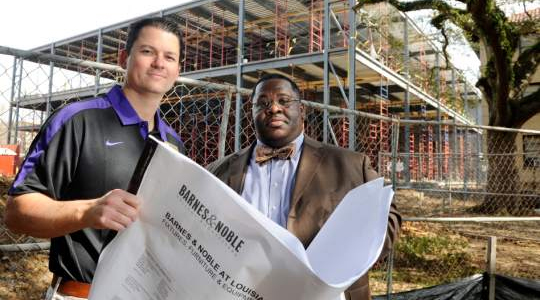 Barnes & Noble at LSU bookstore General Manager Paul Stevenson stands with LSU Director University Auxiliary Services Jason Tolliver in front of the main campus bookstore at the time of its construction.