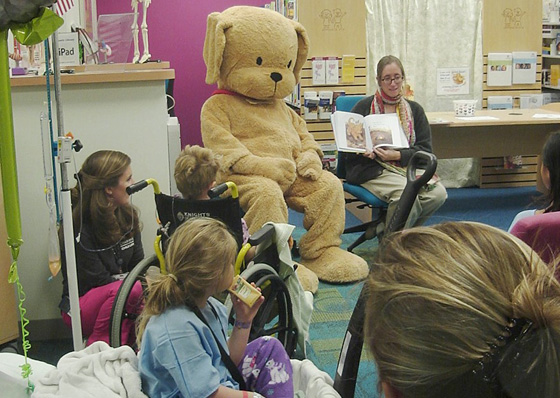 Emory University Bookstore staff Ann Hesketh reads to young patients at Children's at Scottish Rite Hospital in Atlanta, Georgia along with an appearance from Biscuit the dog.