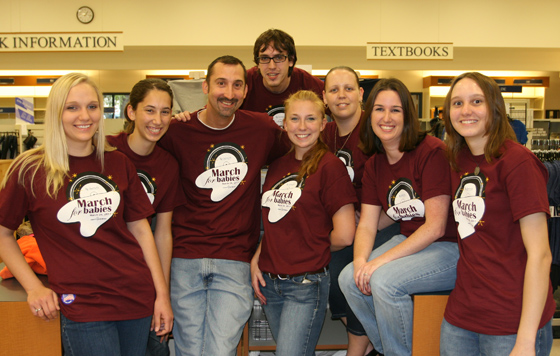 Santa Fe College Bookstore staff, who help raise money for the March of Dimes, pose wearing their March for Babies t-shits.