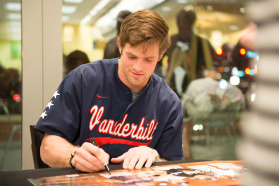 Vanderbilt University outfielder Conner Harrell signs the 2013 Men's Baseball Season poster at Barnes & Noble at Vanderbilt bookstore.