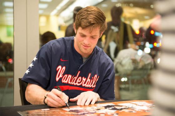 Vanderbilt University outfielder Conner Harrell signs the 2013 Men's Baseball Season poster at Barnes & Noble at Vanderbilt bookstore.