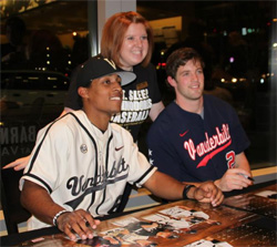 Vanderbilt Baseball's Tony Kemp and Connor Harrell pose for a photo with a fan.