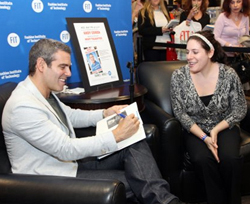 """Bravo TV's Andy Cohen signs a copy of his book """"Most Talkative"""" for a fan at the Barnes & Noble at FIT."""