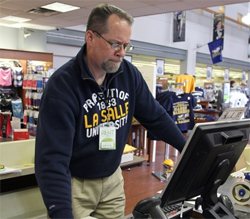 La Salle University Bookstore Manager Mark Allen tracks the online orders that have flooded the store since the beginning of March Madness.