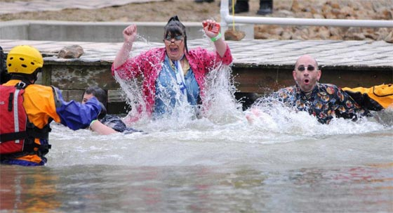 Emporia State University's Memorial Union Bookstore Assistant Manager Lesley Green and Manager Mike McRell plunge into the frigid waters of Mouse Lake to raise money for the Special Olympics.