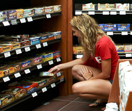 A Rutgers University students shops for a selection of energy bars at the Barnes & Noble at Rutgers University Bookstore.