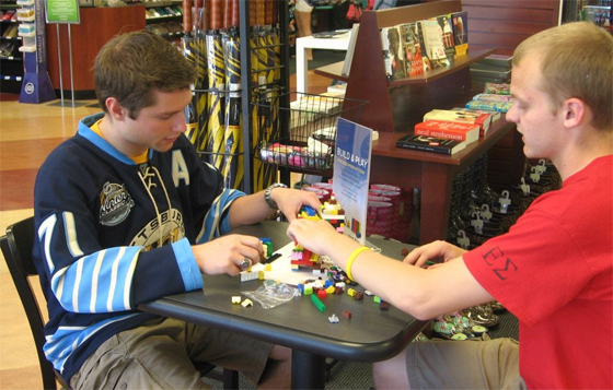 Students participate in the Build & Play challenge at the West Virginia University Bookstore to raise money for Habitat for Humanity.