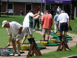 Participants warm up at the driving range at last year's Nassau Community College Golf Outing.