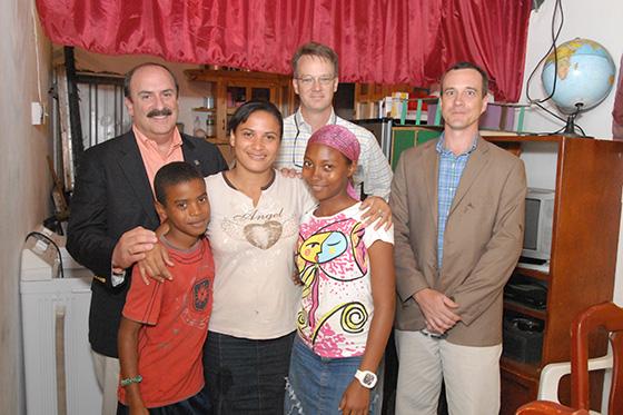 Alta Gracia factory worker Santa Castillo and her children pose with Joel Friedman, Patrick Gross and Joel Kriner of Barnes & Noble College.