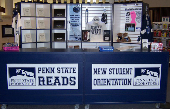 "The Orientation Counter in the Penn State Bookstore where new students can pick up their copyof ""Penn State Reads,"" peer-to-peer introduction to bookstore services, as well as information about the campus and its facilities.."