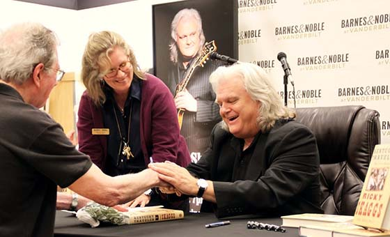 Bluegrass legend Ricky Skaggs greets a fan at the Barnes & Noble at Vanderbilt  bookstore in Nashville, TN. Looking on is Tradebook Manager Cheryl Dalton.
