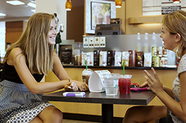 Students enjoying coffee beverages in the Furman University Bookstore cafe.