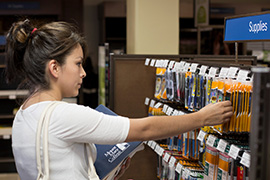 Mount Mary College student selecting items from the school supply section of the bookstore. The MMC Bookstore, previously operated by the college, was outsourced in 2012 to Barnes & Noble College.