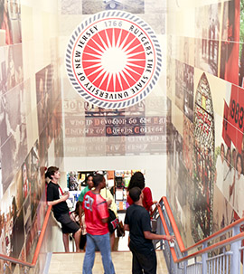 The Rutgers University Bookstore staircase is covered in murals depicting the history and culture of the university.