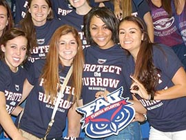 FAU football fans wear their Owl pride at the stadium.