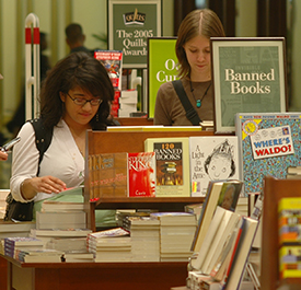 Students browsing through trade books at the DePaul University Loop Campus Bookstore.
