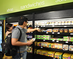 Students choose from a selection of fresh food items at a Barnes & Noble College bookstore.