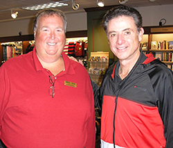 University of Louisville Bookstore Manager Scott Schuknecht with Coach Rick Pitino.