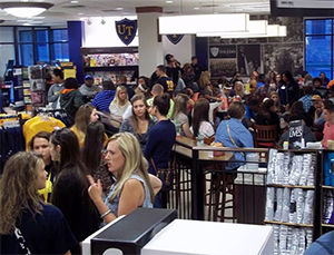 Students crowd the University of Toledo Bookstore on VIP Shopping Night, an exclusive shopping night for freshmen.