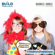 Students pose in the Barnes & Noble College photo booth at the Habitat for Humanity Youth Conference.
