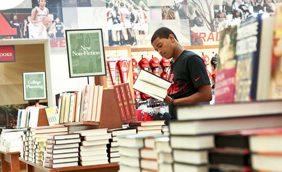 A student browses the general reading section of the Barnes & Noble at Rutgers University Bookstore in New Brunswick, N.J.