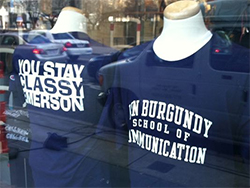 Front and back views of the 'Ron Burgundy School of Communication' t-shirts at the Barnes & Noble at Emerson bookstore.