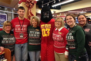 The Gorilla Bookstore staff members pose for a photo in the campus store.