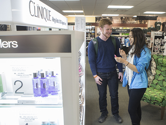 Students shop at the new Clinique make-up counter in the Binghamton University Bookstore.