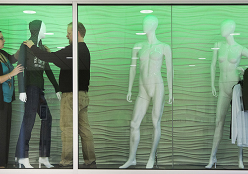 Barnes & Noble at Binghamton University Bookstore Manager Amanda Konopa and General Merchandise Manager Larry Ransom dress a mannequin in the new bookstore display window in the University Union. Photo: Jonathan Cohen