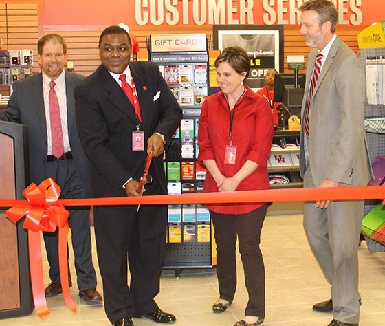 Bookstore general manager Felix Robinson cuts the ceremonial ribbon at the grand opening celebration. Standing with Robinson are (l to r) are    Barnes & Noble College Regional Manager Marc Eckhart.