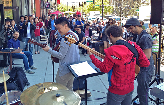 Students perform outside the Berklee College of Music Bookstore in Boston, Massachusetts.