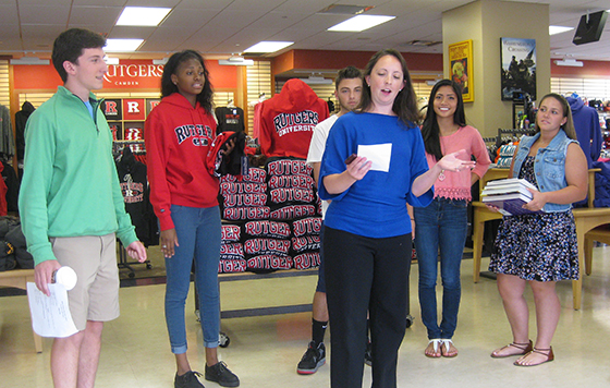 University District Bookstore Assistant Manager Amanda Howe works with students who participated in the BizEd summer program at Rutgers School of Business Camden.