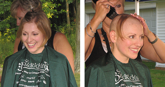 Lisa Loughan has her head shaved to raise money to fight children's cancer at a St. Baldrick's event.