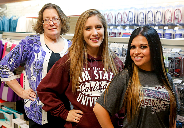 NMSU Carlsbad Bookstore Manager Frankie Miller (far left) poses with two of her student booksellers, Taylor Nalley and Natawsha Cota.