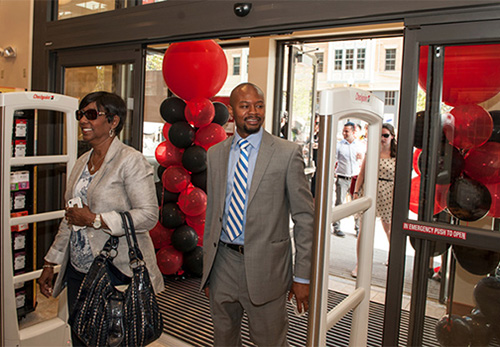 Representatives of CUA enter the new Barnes & Noble at The Catholic University of America bookstore in Washington, D.C. The new store anchors the Monroe Street Market redevelopment project and opened in July.