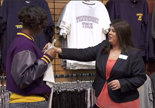 Store Manager Greer Hallmark assists a student in the Tennessee Technological University Bookstore.