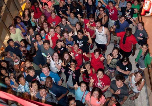 "Texas Tech students get their ""guns up"" at the VIP Shopping event at the Texas Tech University Bookstore."