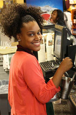 Bloomfield College student Shabera Jones prepares a beverage in the new Starbucks cafe in the Barnes & Noble at Bloomfield College bookstore.