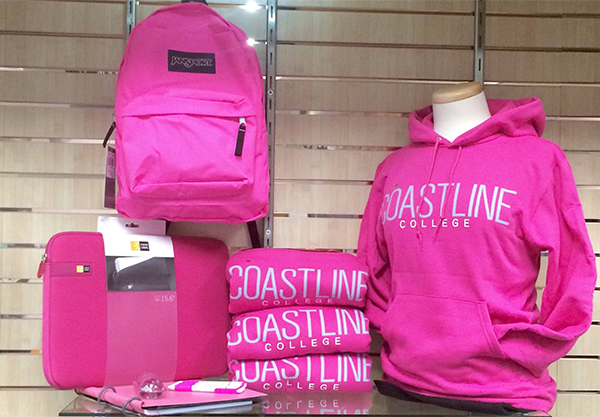 A selection of new school-branded apparel and merchandise is displayed in the Coastline Community College Bookstore.