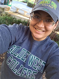 Golden West College student Andrea Carranza snaps a selfie in her Golden West College sweatshirt and hat, purchased from the bookstore.