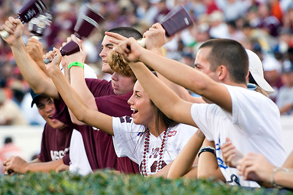 Mississippi State University Bulldog fans shake the school's traditional cowbells at football games. Cowbells are a Game Day top seller in the school's campus bookstore.