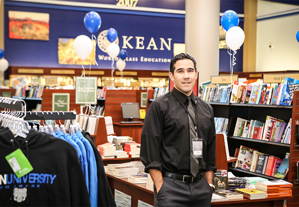 Acting Bookstore Manager Jason Figueroa stands inside the trade book section of the new Barnes & Noble at Kean University bookstore.