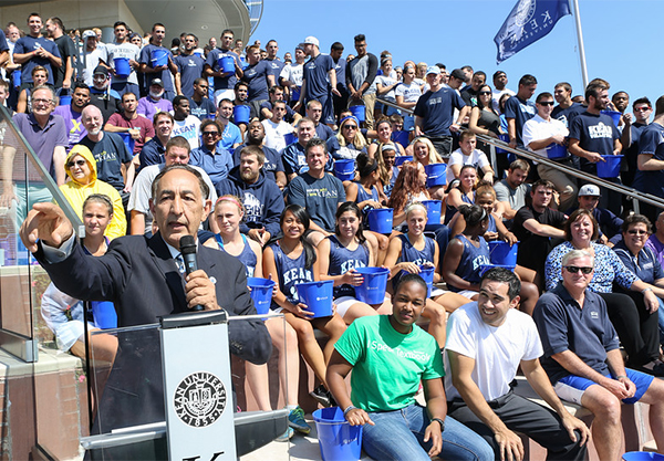 Kean University President Dr. Dawood Farahi addresses the audience moments before over he and 200 students, faculty and staff participate in the ALS Ice Bucket Challenge. The event raised $40,000 to help find a cure for ALS.