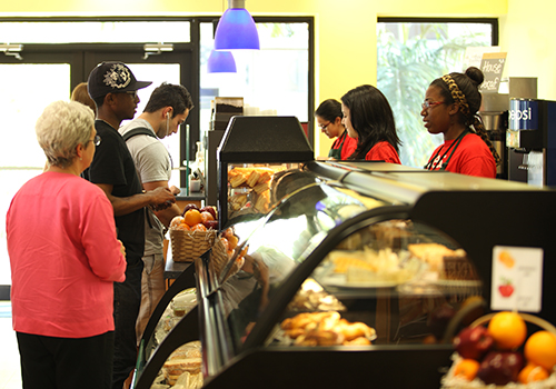 Customers selecting items for purchase at the FIU Cafe at Florida International University.