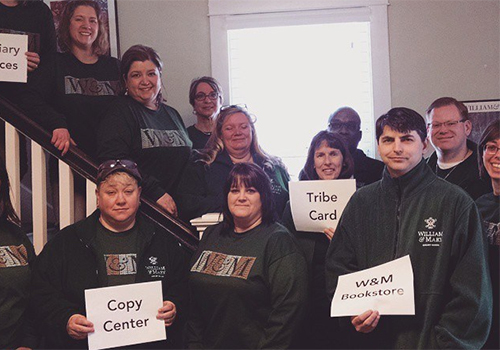 William & Mary department members model the Charter Day t-shirt, including William  Mary Bookstore Manager, Cathy Pacheco (back row, 2nd from left).