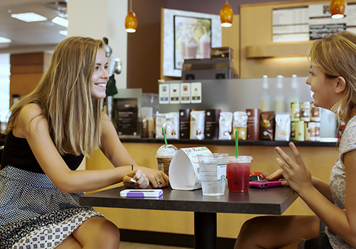Furman University students meet over cold drinks at bookstore cafe.