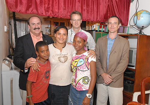 Santa Castillo and her children with Joel Friedman, Patrick Gross and Joel Kriner.