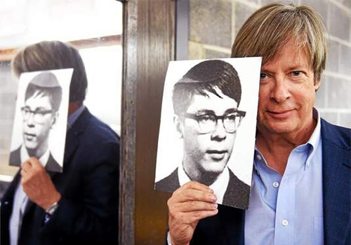 Pulitzer Prize-winning humorist Dave Barry poses backstage at Southern Connecticut State University's Lyman Center with a photo from his 1965 high school yearbook.