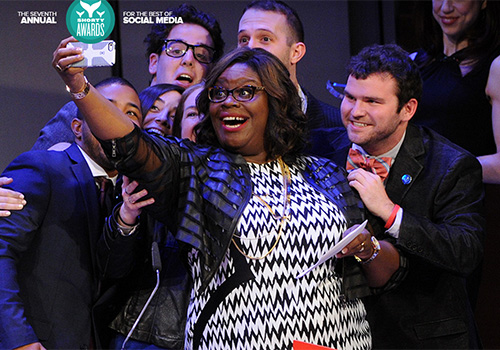 Comedian and actress Retta takes a selfie with Boston University Assistant Dean Micha Sabovik and members of the winning BU COM social media team at last year's Shorty Awards.