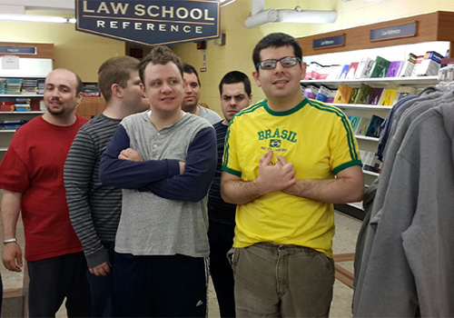 Young adult students from the Genesis Eden II program gather to begin work in the Hofstra University Bookstores. The students visit the store twice a week and gain important social and communication skills.